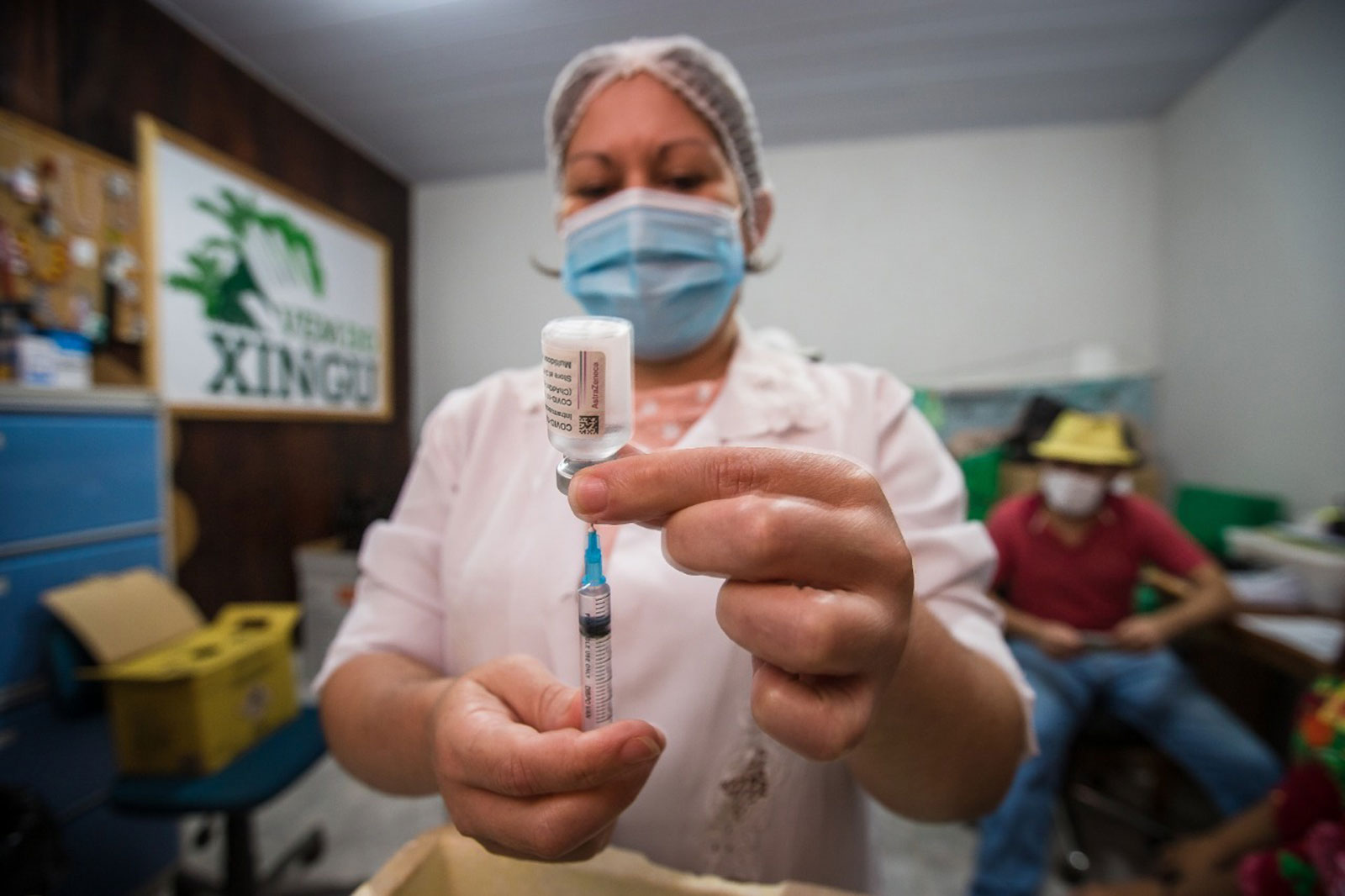 A nurse filling a syringe with the COVID-19 vaccine