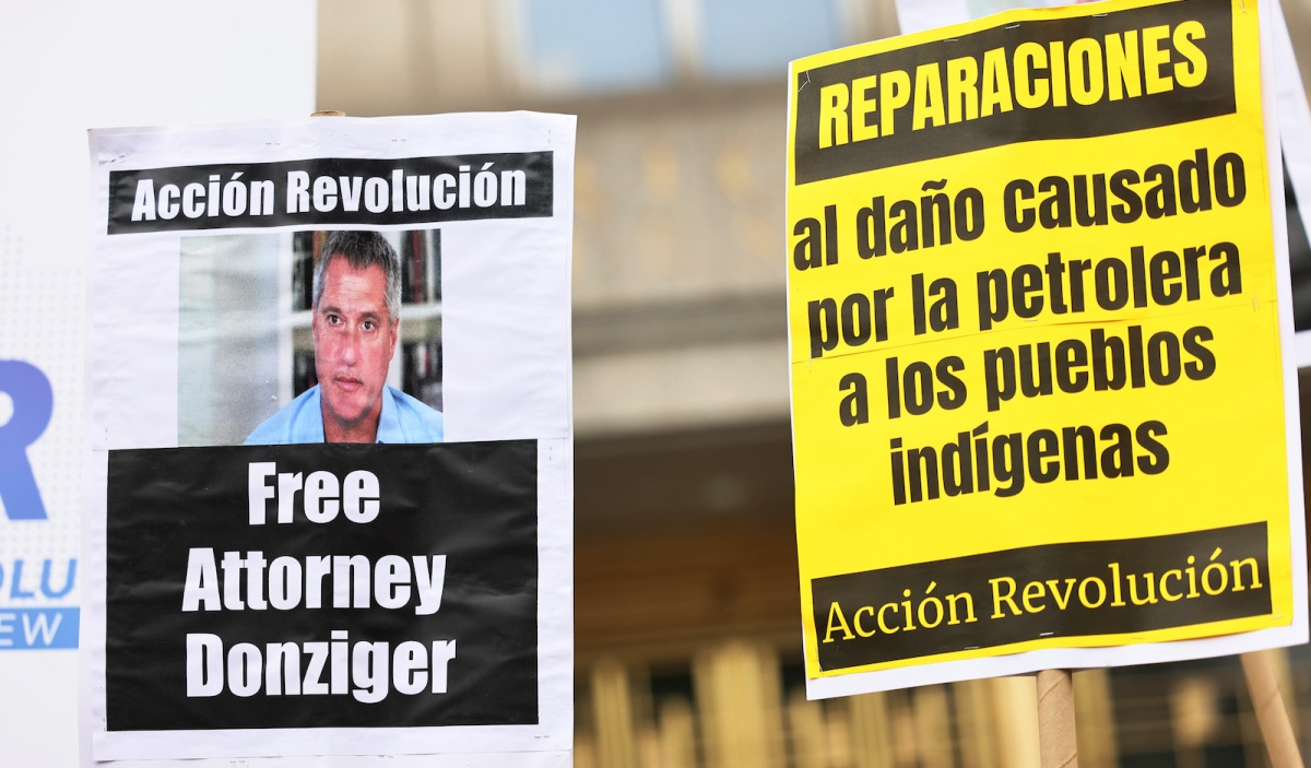 Posters call for the release of attorney Steven Donziger.