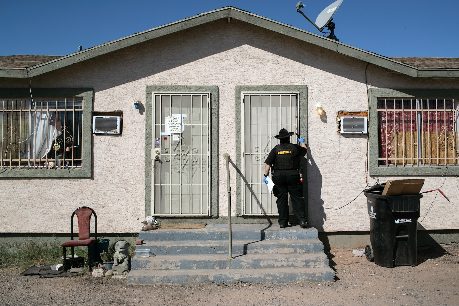 Maricopa County constable Darlene Martinez knocks on a door before posting an eviction order on October 1, 2020 in Phoenix, Arizona.