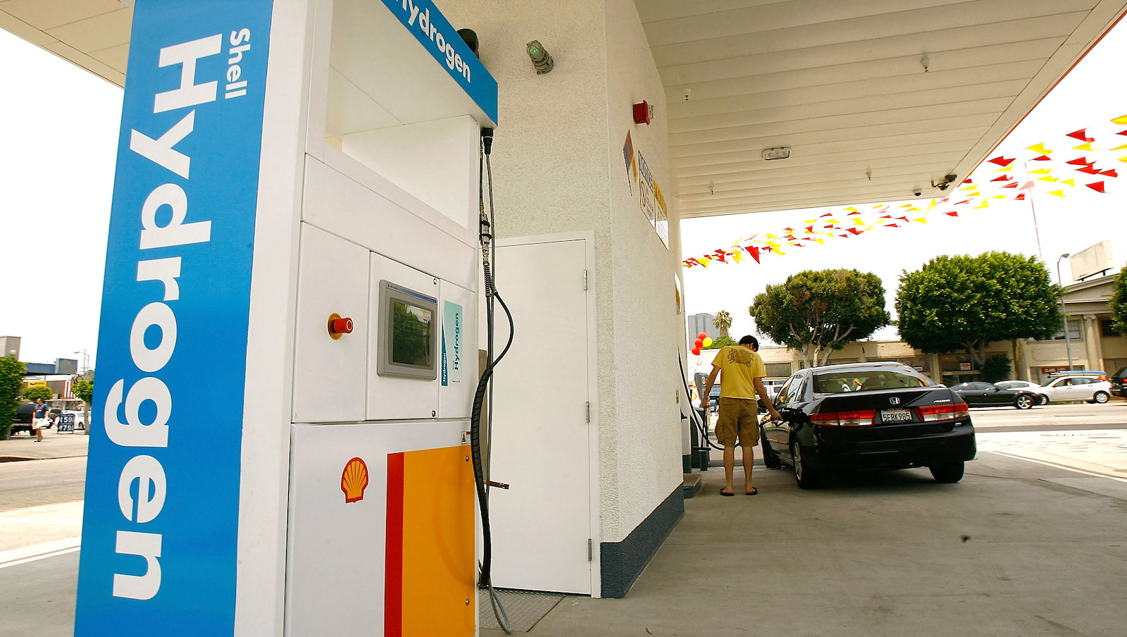 A man fills his car at a hydrogen fueling station in Los Angeles.