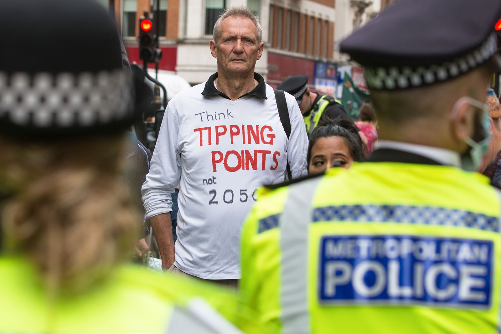 An environmental activist from Extinction Rebellion wears a t-shirt referring to climate tipping points