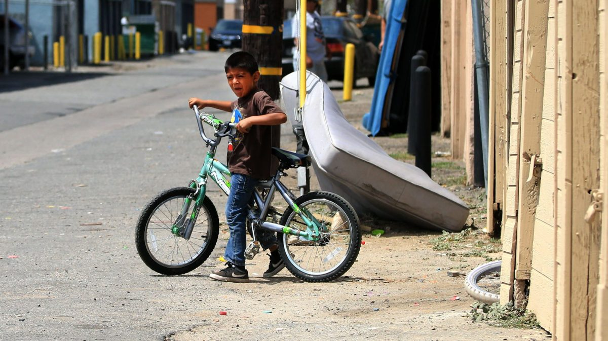 Santa Ana child on bike