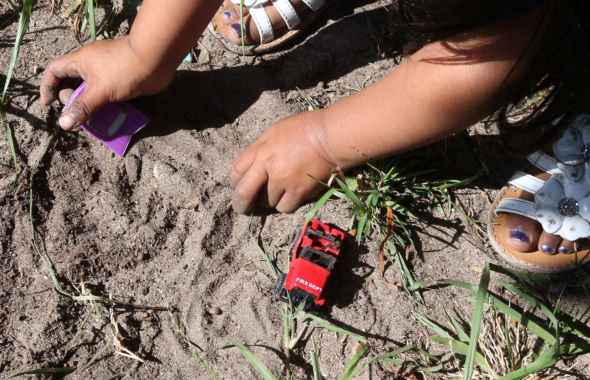 young kid playing in dirt in Santa Ana