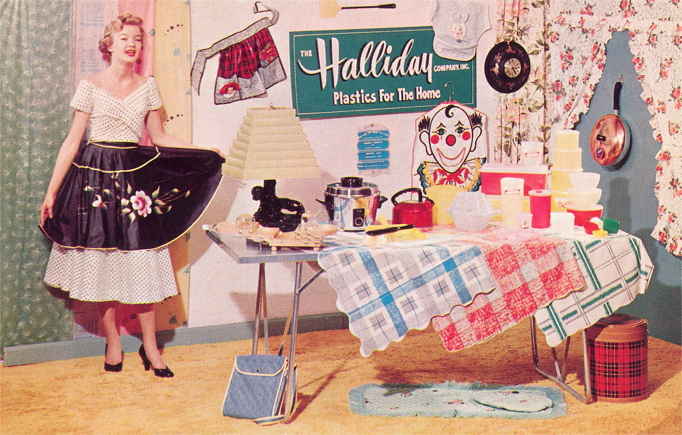 An old-fashioned display of household items like containers, tablecloths, and signs made from plastic.