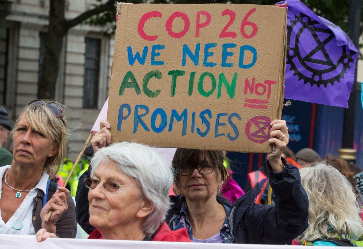 An activist holding a sign that reads