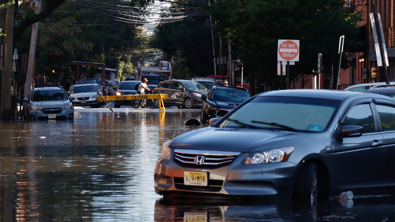 An abandoned car sits on a flooded street in Hoboken, New Jersey