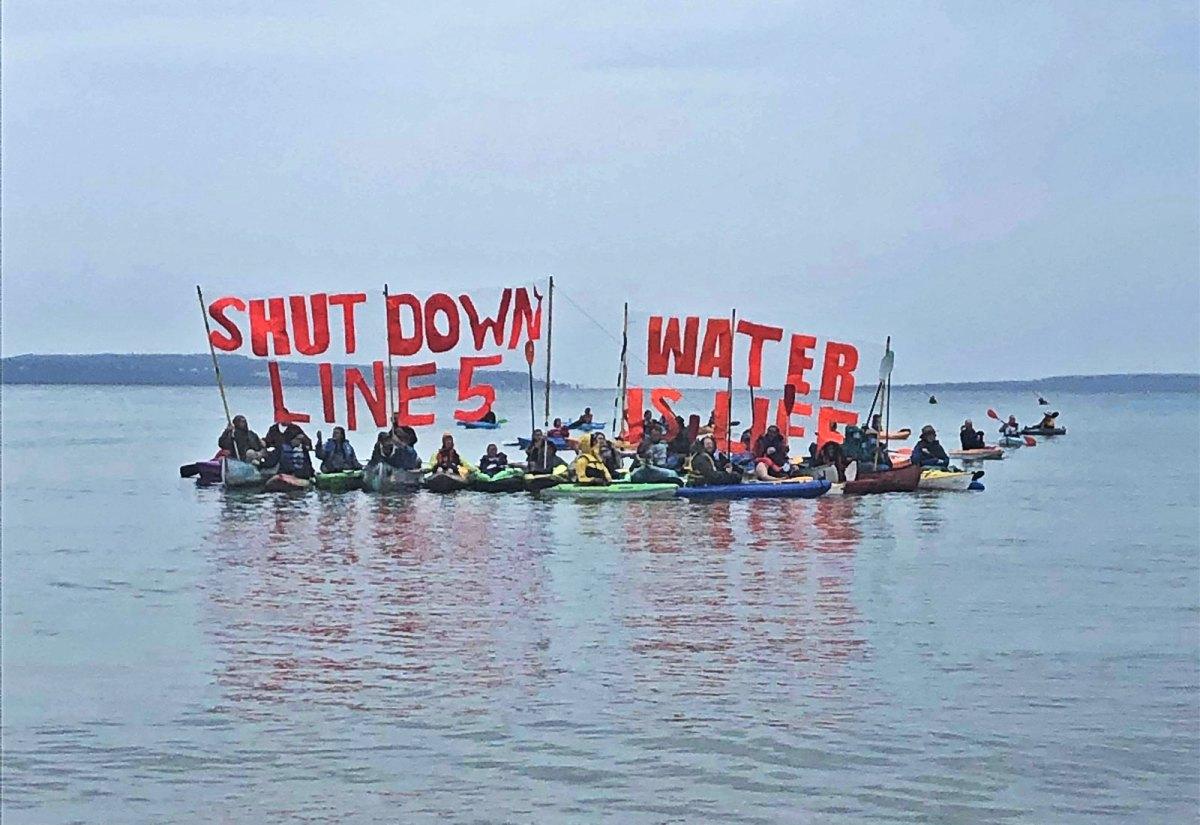 People on kayaks protesting Line 5