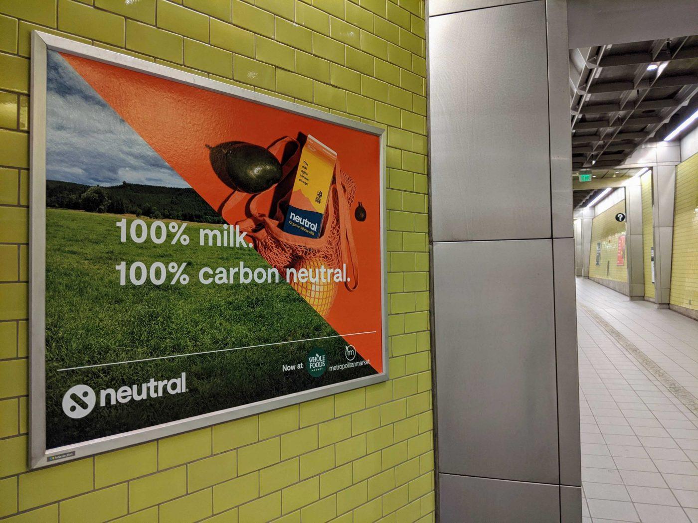 "An advertisement says ""100% milk. 100% carbon-neutral."""