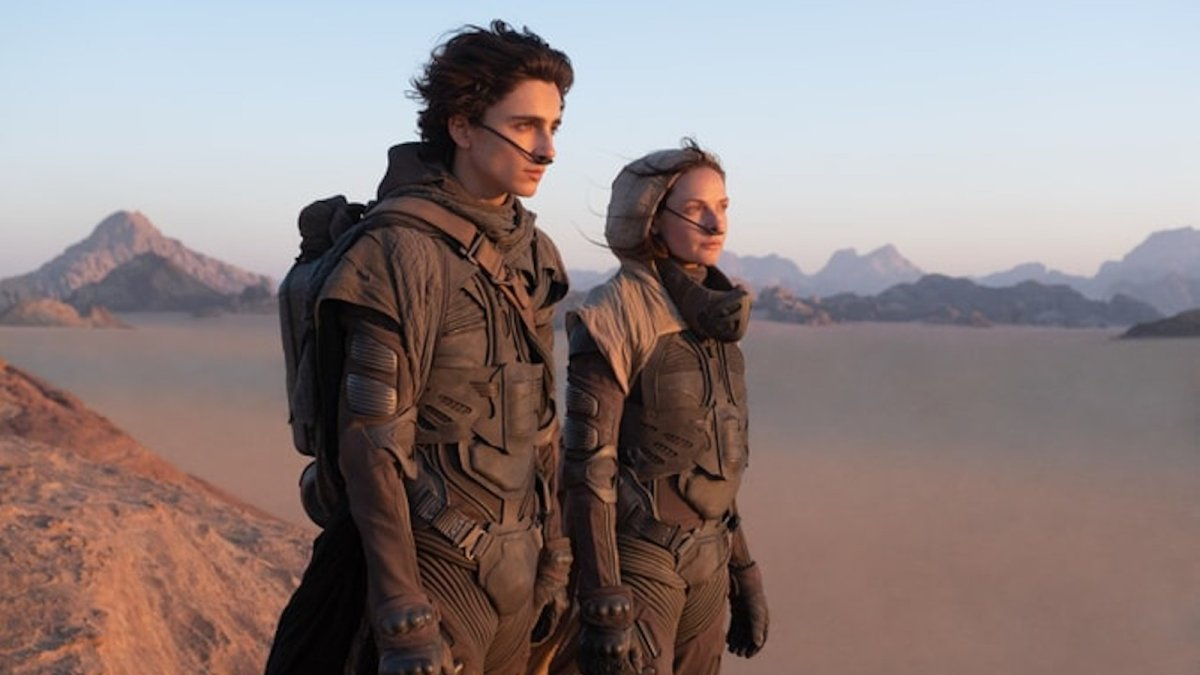 Dune protagonists look out over the desert.