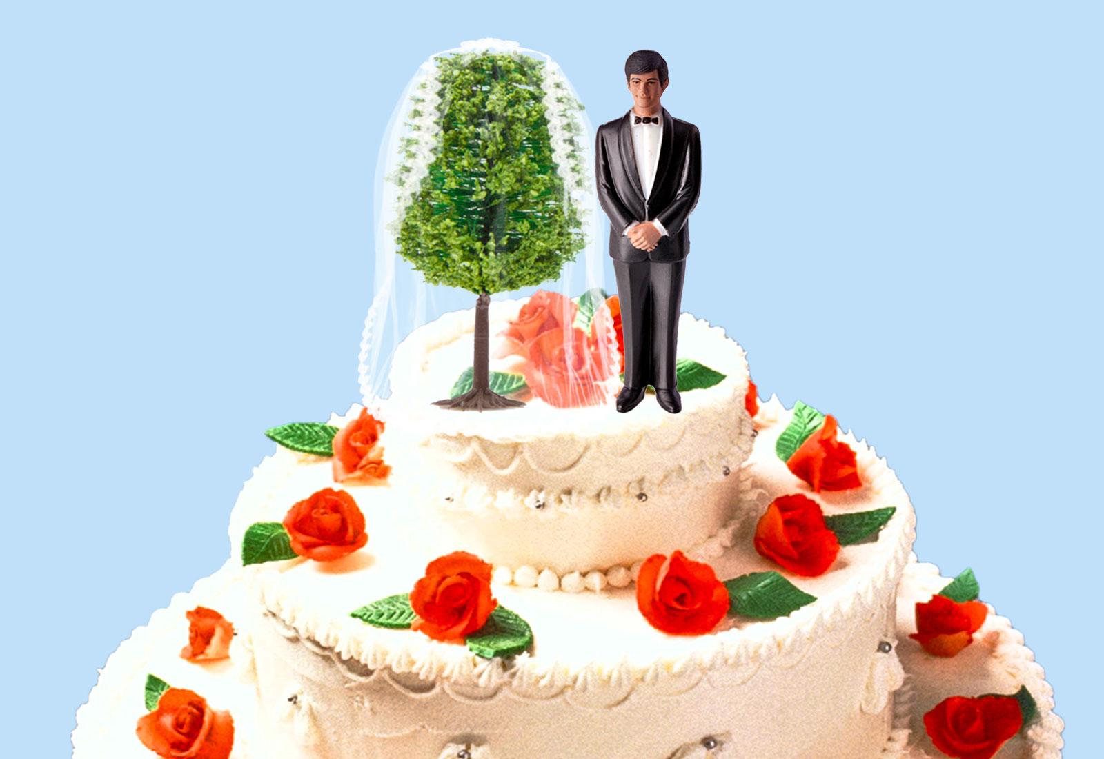 Wedding cake with a groom topper and a tree wearing a bridal veil