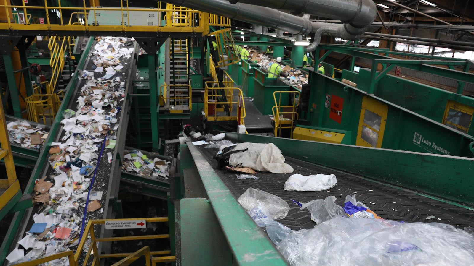 Conveyor belt with plastic on it.