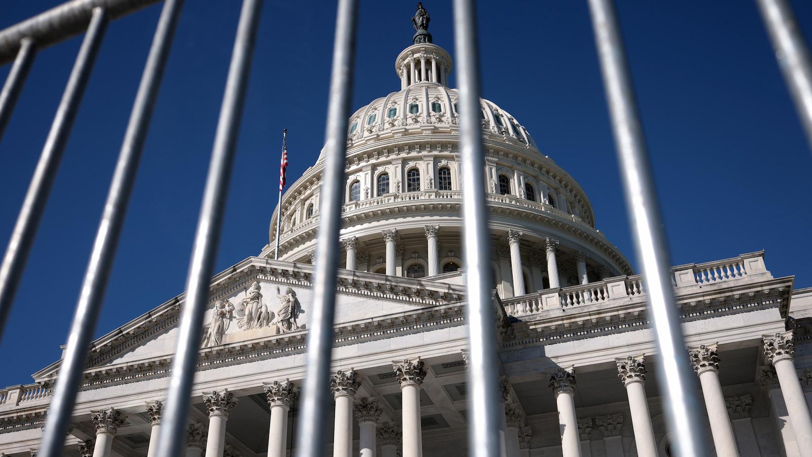 Capitol building through a fence